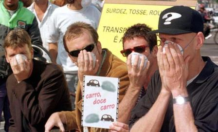 Midnight Oil protesting in Sao Paulo, 1997: (l-r) guitarists Martin Rotsey and Jim Moginie, drummer Rob Hirst, singer Peter Garrett