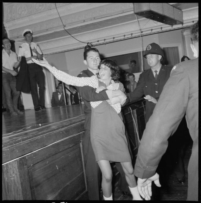 A Rolling Stones fan is restrained at the Wellington Town Hall, Feb. 8, 1965 (Not my mother, mercifully, who was probably focused on her wedding 2 days later)